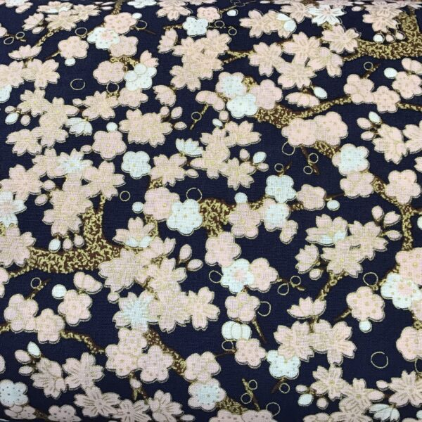 """Cherry Blossom PO2642 Pink Gold on navy blue fabric. 54"""" wide"""