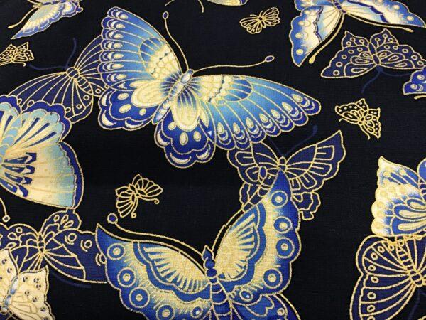 "Butterflies PO2362 Blue gold on Navy blue fabric. 54"" wide"