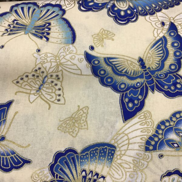 """Butterflies PO2361 Blue gold on cream fabric. 54"""" wide"""